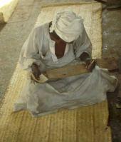 Sudanese copying Qu'ran on Acacia board. Fabaceae
